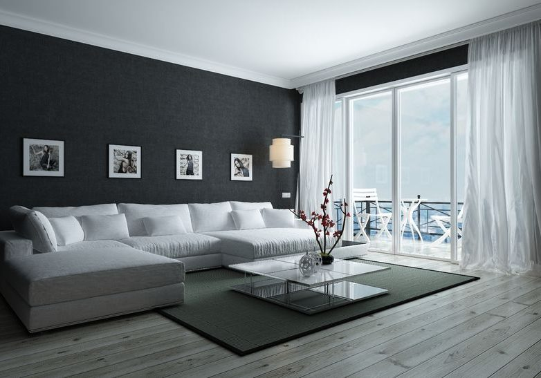 50410310 - contemporary black and white living room with stylish interior decor, an upholstered lounge siite and glass door leading to an outdoor patio, 3d render